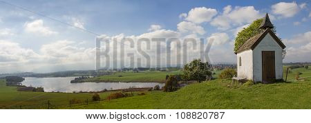 Rural Bavarian Panorama With Little Chapel And Lake View