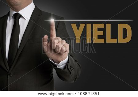 Yield Touchscreen Is Operated By Businessman Concept