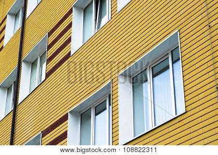 Many Windows In Yellow Brick Building
