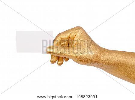 Golden hand holding an empty business card