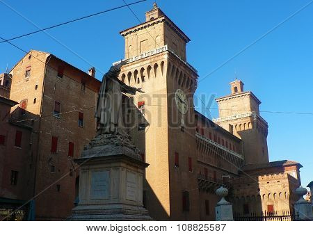 Ferrara, Italy - October 7, 2009: Statue Of Philosopher Near Castle With Chapel
