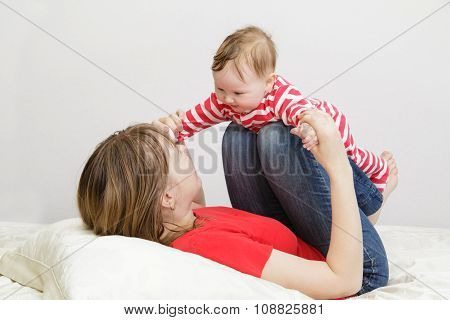 mother and child playing at home