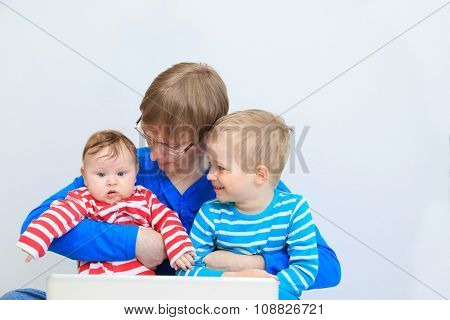 father with kids with laptop at home