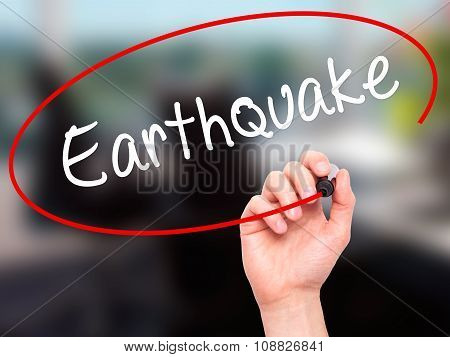 Man Hand writing Earthquake with black marker on visual screen