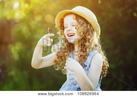 Laughing Curly Girl With A Butterfly On His Hand. Happy Childhood Concept. Background Toning For Ins