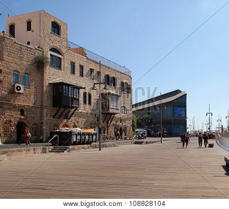 Tourists On The Waterfront At The Famous Old Port Of Jaffa In Tel Aviv
