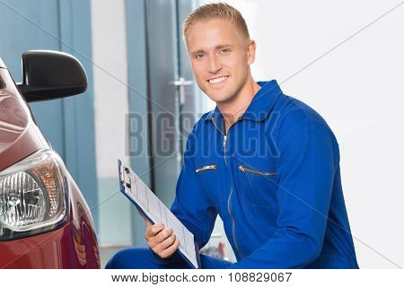 Mechanic Holding Clipboard