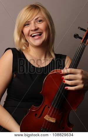 portrait of the nice fair-haired girl with a violin