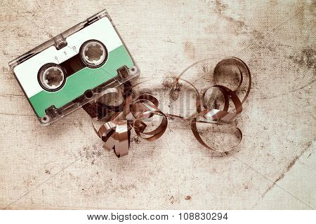 Cassette With Pulled Out Tape On Dirty Canvas