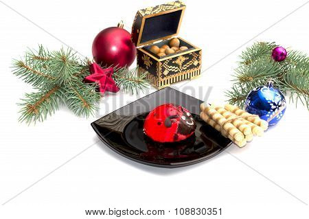 Coniferous Branch, Red Cake On A Plate And Nutlets