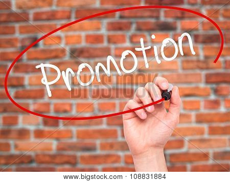 Hand writing Promotion with marker on visual screen.
