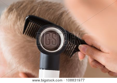 Doctor Examining Patient's Hair Through Dermatoscope