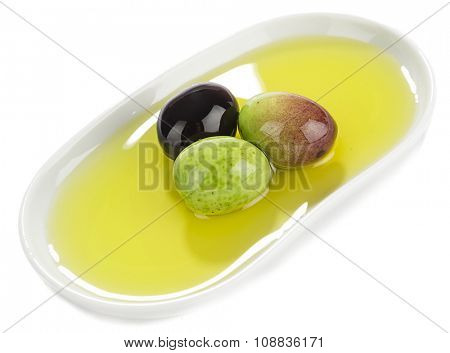 Variety of olives in porcelain dish isolated on white background.