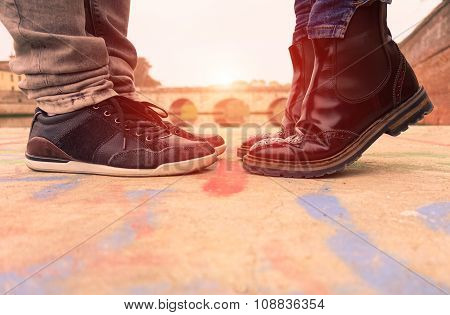 Young Couple Kissing Outdoors - Lovers On A Romantic Date At Sunset