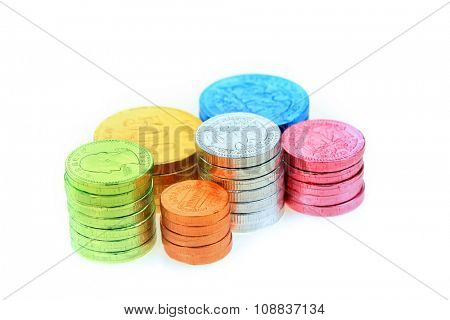 Colorful candy coins on white background