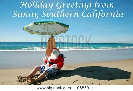 Santa Claus Relaxes on a Beautiful and Exotic Beach while on Vacation. Focus on Santa's Face.
