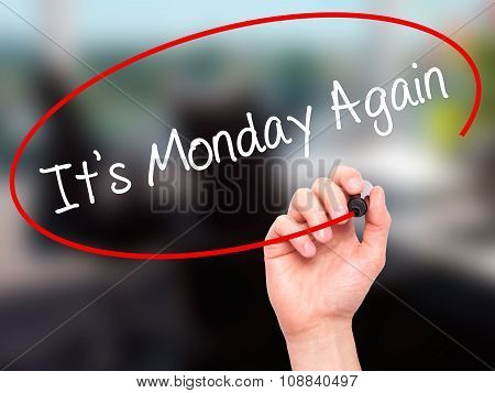 Man Hand writing It's Monday Again with black marker on visual screen.