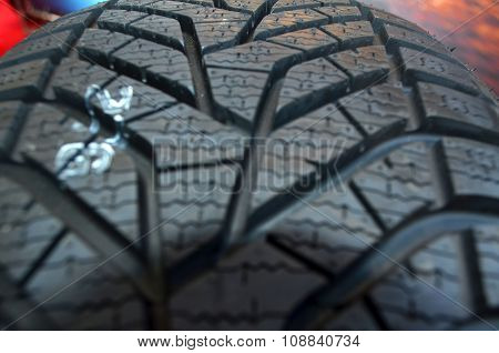 Close Up Of High Performance Tire In A Auto Repair Garage Or A Tires Shop
