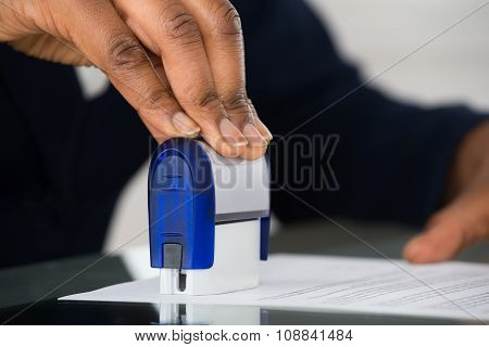 Person's Hand Stamping Document