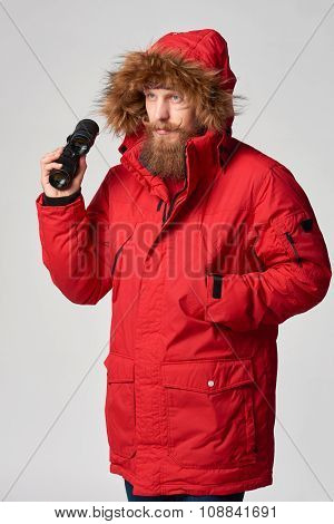 Man wearing red winter Alaska jacket  with fur hood on