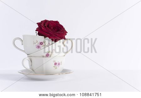 white cups decorated overlaid with a rose inside