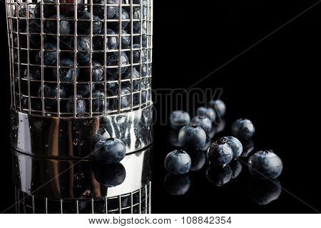 Blueberries in cup strainer from side