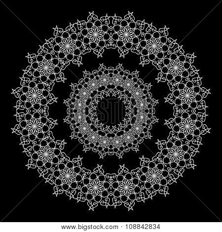 Circular White Lace Ornament on Black Background