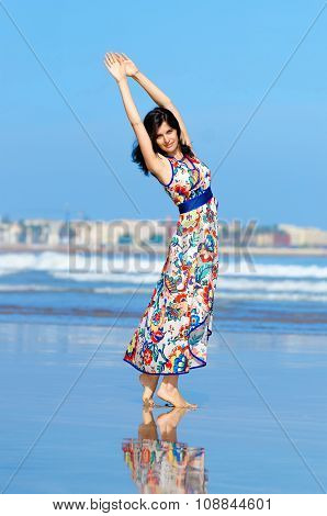 Young Girl Dancing At The Beach