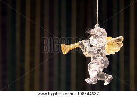 Christmas angel with pipe on vintage background