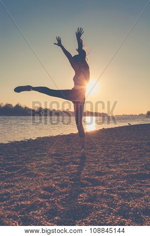 young happy girl dance on lake beach at sunset, silhouette, full body shot