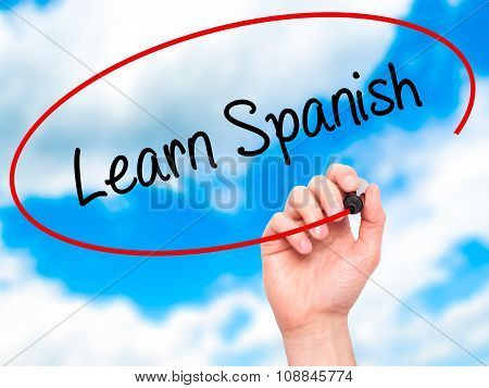 Man Hand writing Learn Spanish with marker on visual screen.