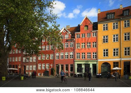 COPENHAGEN-DENMARK SEPT 2 2015:  Grabrodretorv is a public square in the centre of Copenhagen, Denmark.  The square is characterized by colorful house fronts and dominated by a large plane tree.