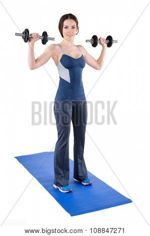 young woman fitness instructor shows starting position of standing dumbbell shoulder press, isolated on white