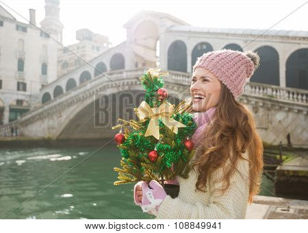 Woman With Christmas Tree In Venice Looking Into Distance