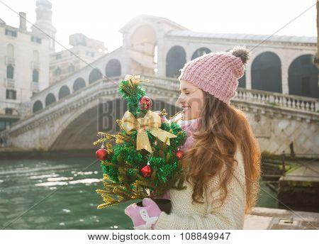Woman With Christmas Tree Near Rialto Bridge In Venice, Italy