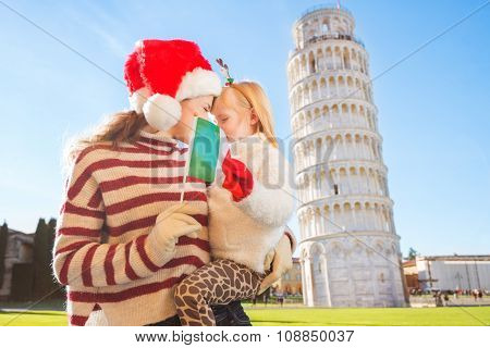 Mother And Daughter Holding Italian Flag. Christmas In Pisa
