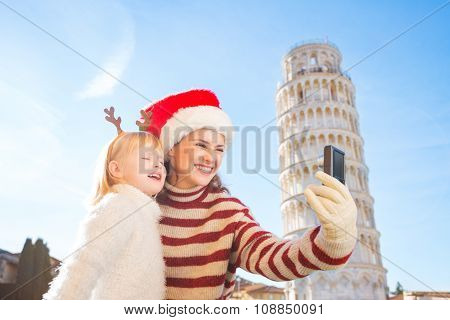 Mother And Daughter Taking Selfies. Christmas In Pisa