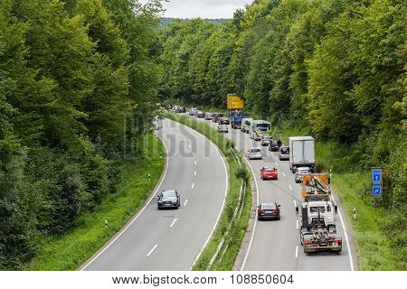 A light traffic jam with rows of cars. Traffic on the highw