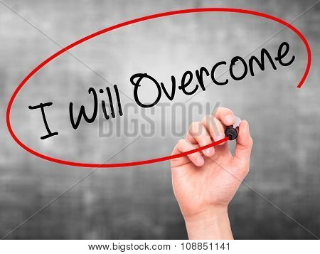 Man Hand writing I Will Overcome with marker on visual screen.