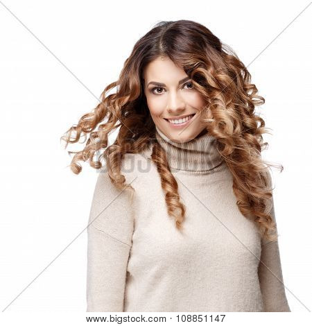 Beautiful young woman in knitted wool sweater smiling