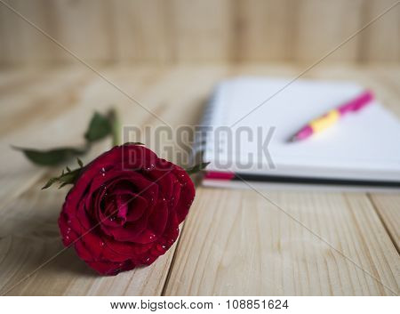 Red Rose And Notebook Page