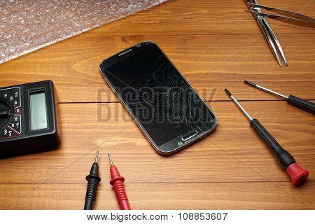 Broken Smartphone With Tools