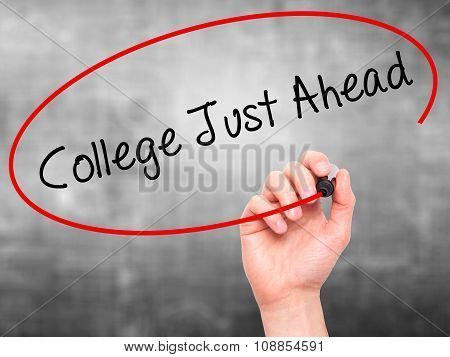 Man Hand writing College Just Ahead with marker on visual screen