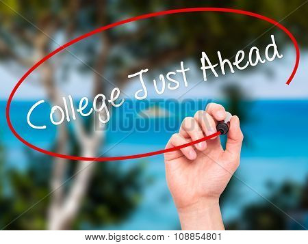 Man Hand writing College Just Ahead with marker on visual screen.