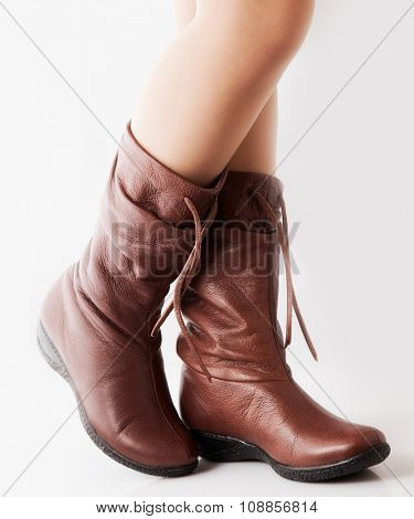 Beautiful female legs in brown boots