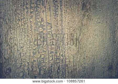 Old wooden surface with peeling green paint color
