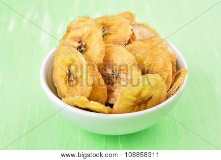 Homemade Banana Chips In White Bowl