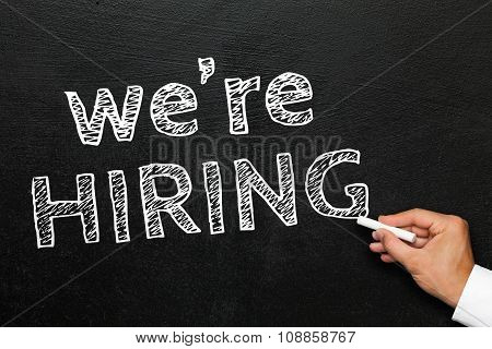 We are hiring. Blackboard with hand. Business opportunities.