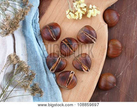 Roasted chestnuts on wooden cutting board