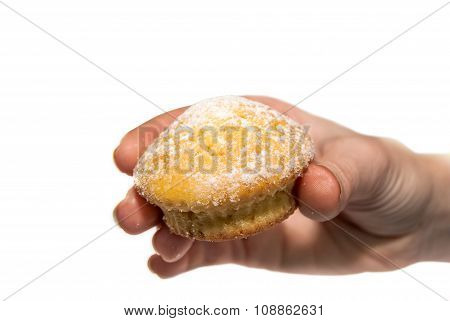 muffin in the woman's hand on white background